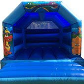 a blue Dinosaurs themed Bouncy Castle