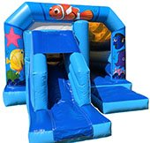 blue bouncy castle with an under the sea theme with a slide at the front