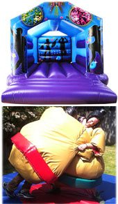 purple adult bouncy castle and two adult wearing sumo suits
