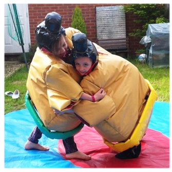 children playing wearing sumo suits